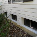 Laughlin, basement windows after we installed James Hardie siding and trim.